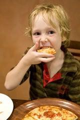 Eating pizza at lakiss