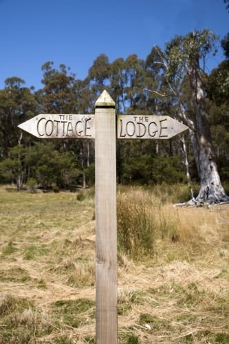 Adventure Bay Retreat Cottage and Lodge Sign