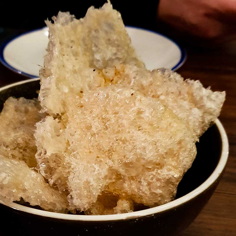 Meatmaiden Bar & Grill - Puffed Pork Scratchings with Spiced Salt.